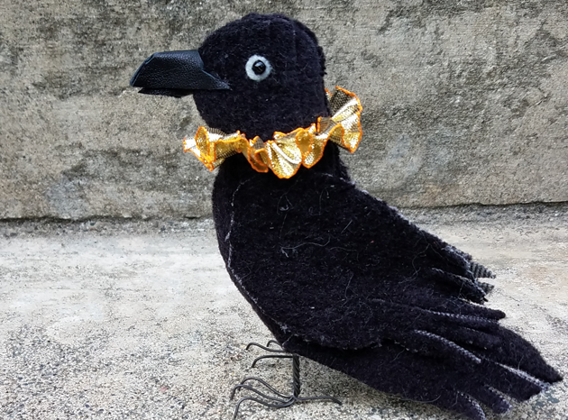 Handmade fabric crow toy with gold ruff